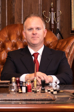 Dallas criminal defense attorney Richard McConathy sits behind his desk