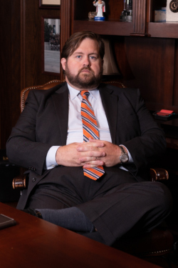 Dallas attorney Brian Bolton sits at his desk