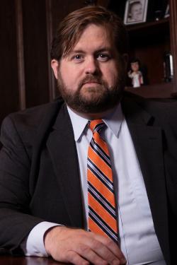 Dallas DWI attorney Brian Bolton sits at his desk
