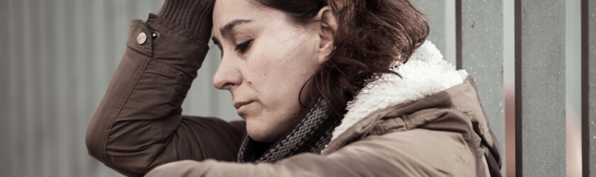 Close-up of sad woman leaning her head on her hand